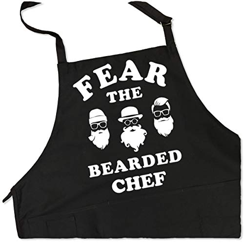 ApronMen - Fear The Bearded Chef - Funny BBQ Apron for Dads - 1 Size Fits All Chef Quality Cotton 4 Utility Pockets, Adjustable Neck and Extra Long Waist Ties - Black Color